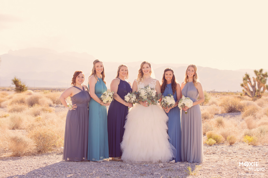 bride and her bridesmaids in blue dresses at the Las Vegas Paiute Golf Resort