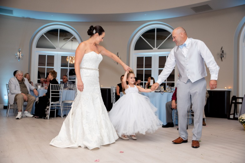 Las Vegas Couple dances with flower girl in adorable white dress