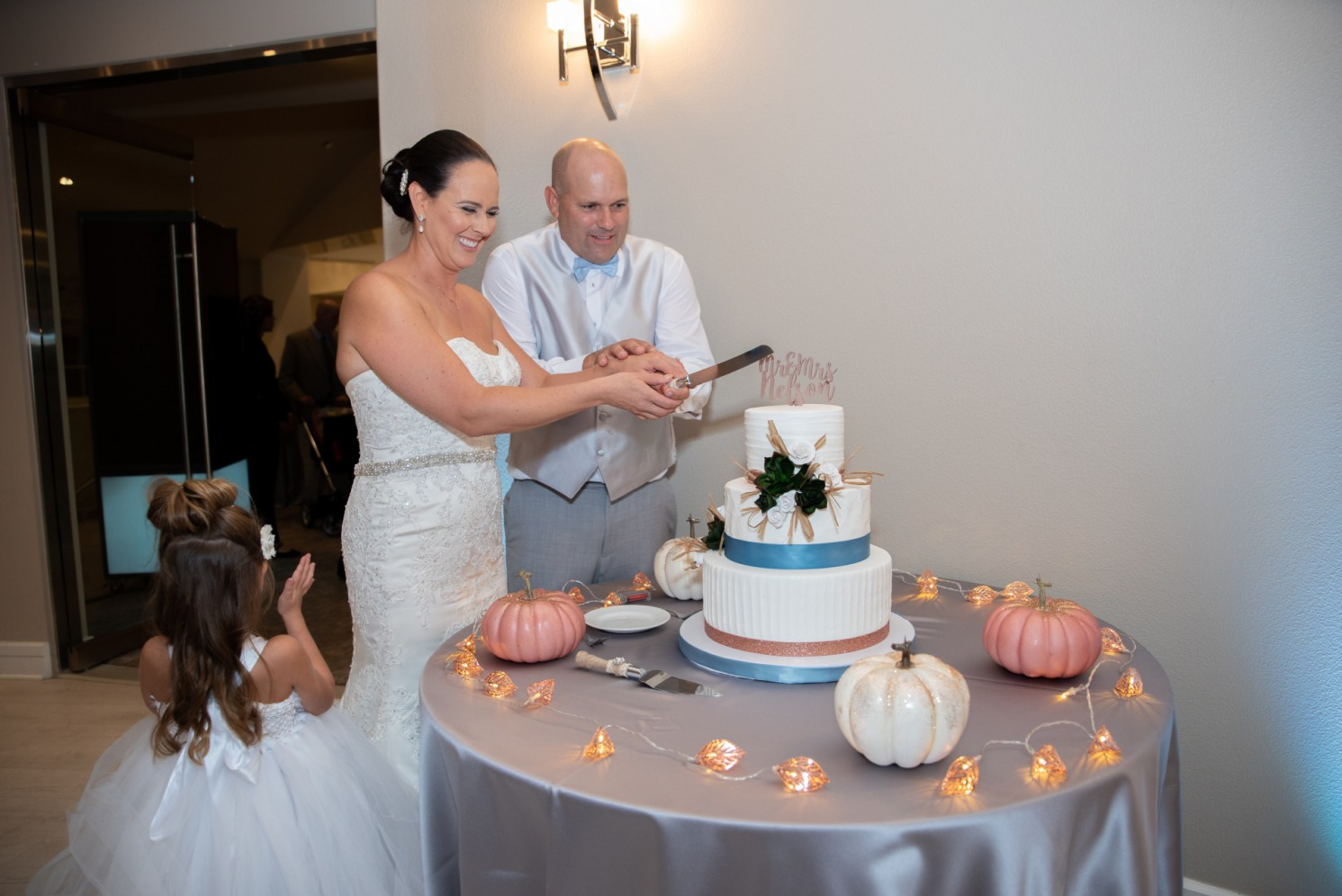 Blue Fall Wedding Inspiration. Happy Las Vegas couple cut the cake at their Reflection Bay Golf Club wedding.