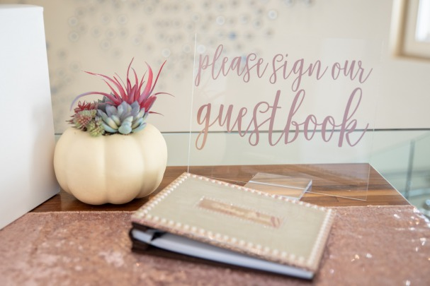 "Blue Fall Wedding Inspiration. cute guestbook with pumpkin centerpiece and a sign saying ""Please Sign our Guestbook"" nearby. cute wedding details"