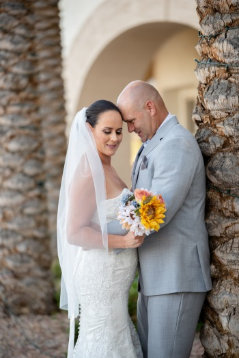 Las Vegas Couple poses romantically surrounded by palm trees