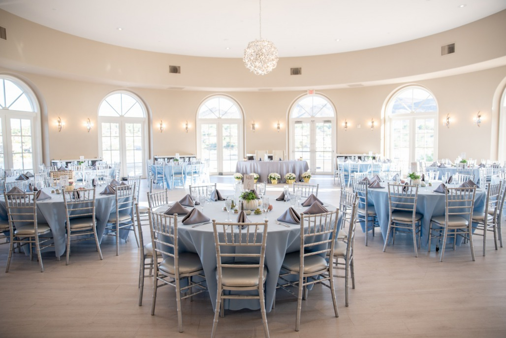 dusky blue table settings in a stunning white rotunda room at Reflection Bay Golf