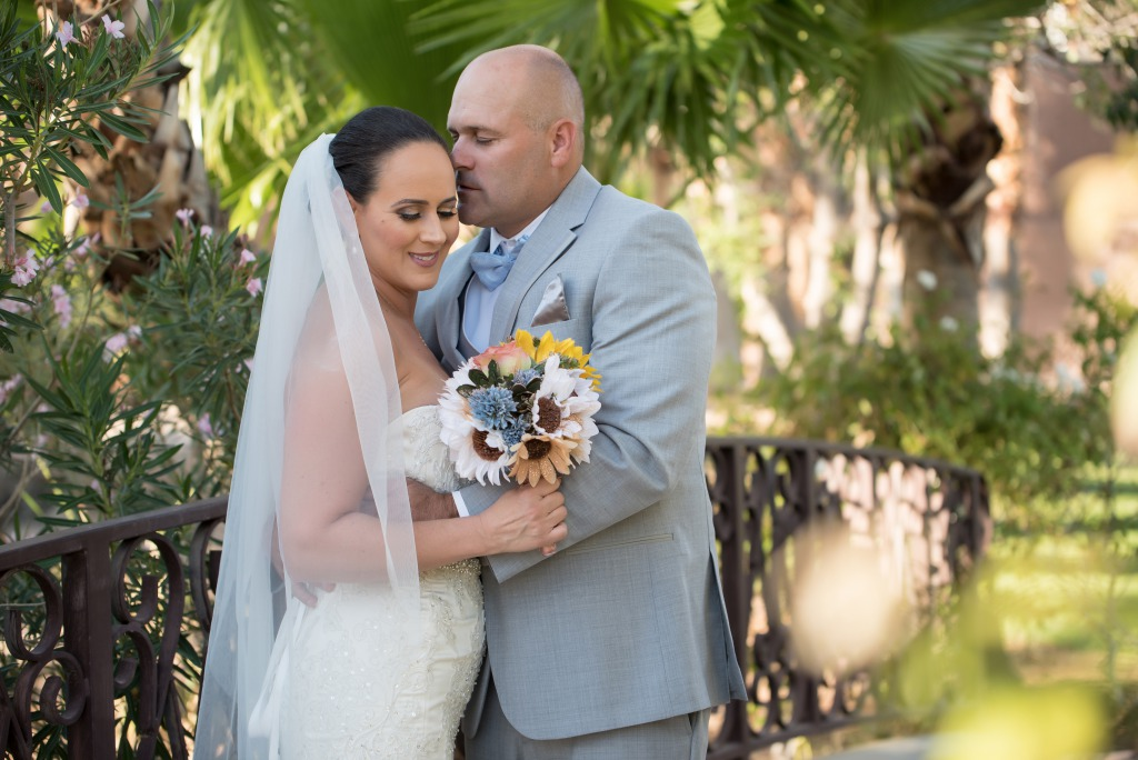 Las Vegas Groom kisses his lovely bride on the forehead at reflection bay golf club