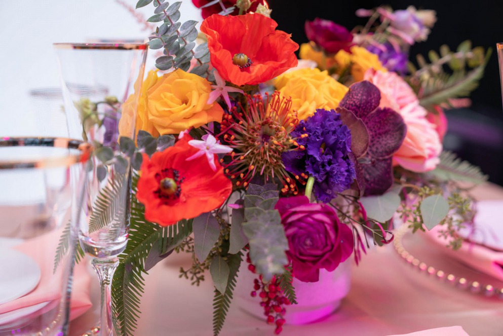 wildflower centerpiece in jewel tones by flora couture created for Spectacular Weddings Live
