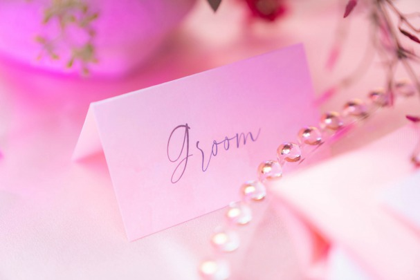 groom place card on tablescape by paper and home for spectacular weddings live by bridal spectacular