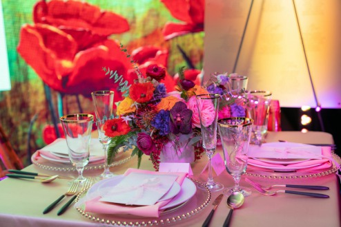 Champagne tablescape with pops of color by Symphony weddings & Events on Spectacular Weddings Live