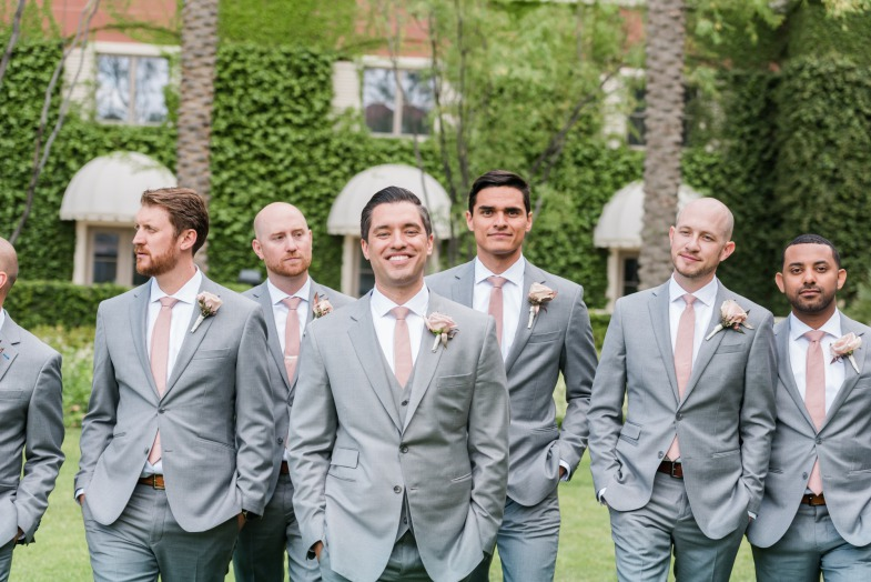 Groom with Groomsmen in gray suits with dusty rose accents at the Las Vegas JW Marriott Resort & Spa