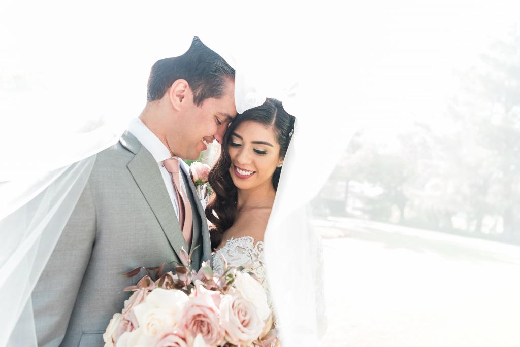 Happy bride and groom capturing a elegant photo at JW Marriott Resort & Spa Las Vegas