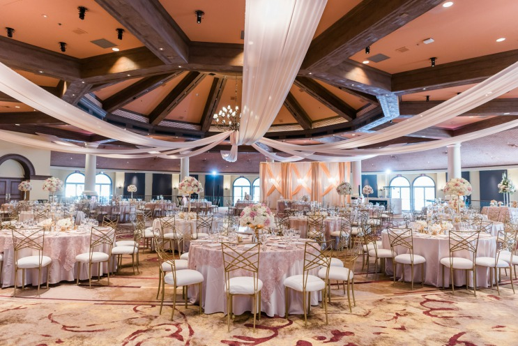 A elegant gold and dusty rose spring wedding reception ready for a wedding filled with happy couples and guests at the JW Marriott Resort & Spa in Las Vegas.