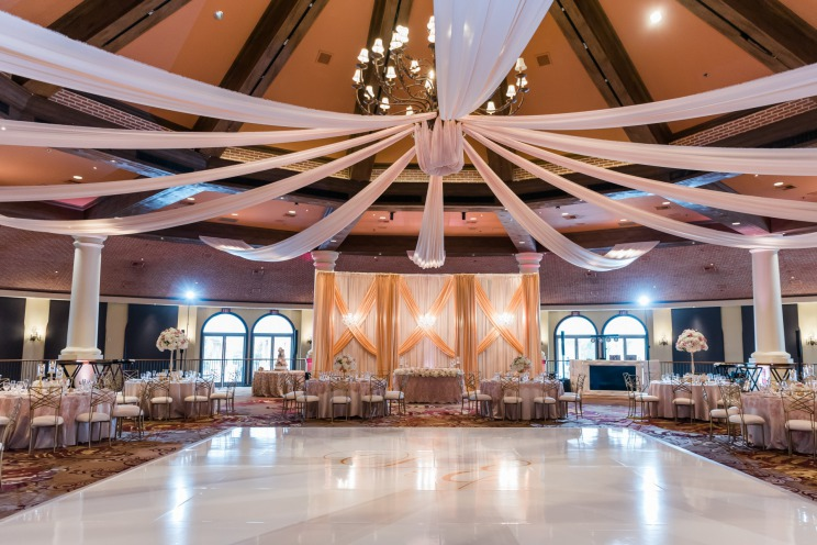 A elegant May wedding reception ready for a wedding filled with happy couples and guests at the JW Marriott Resort & Spa in Las Vegas.