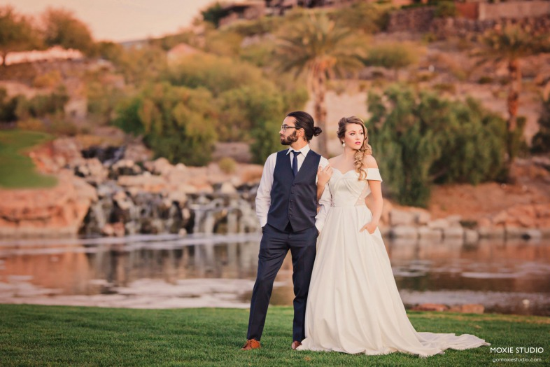 Bride and Groom near waterfall at DragonRidge Country Club