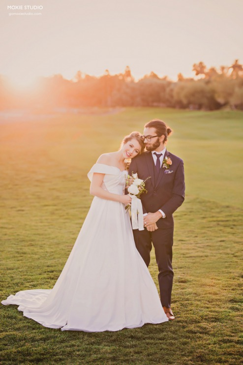 Happy Bride and Groom outside at sunset at DragonRidge Country Club