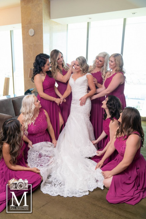 Brides with bridesmaids in purple gowns