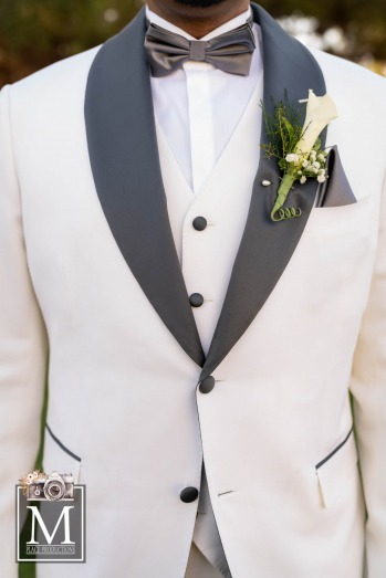 Groom in white and black tux