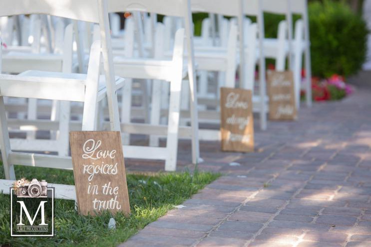 A garden wedding ceremony custom signs