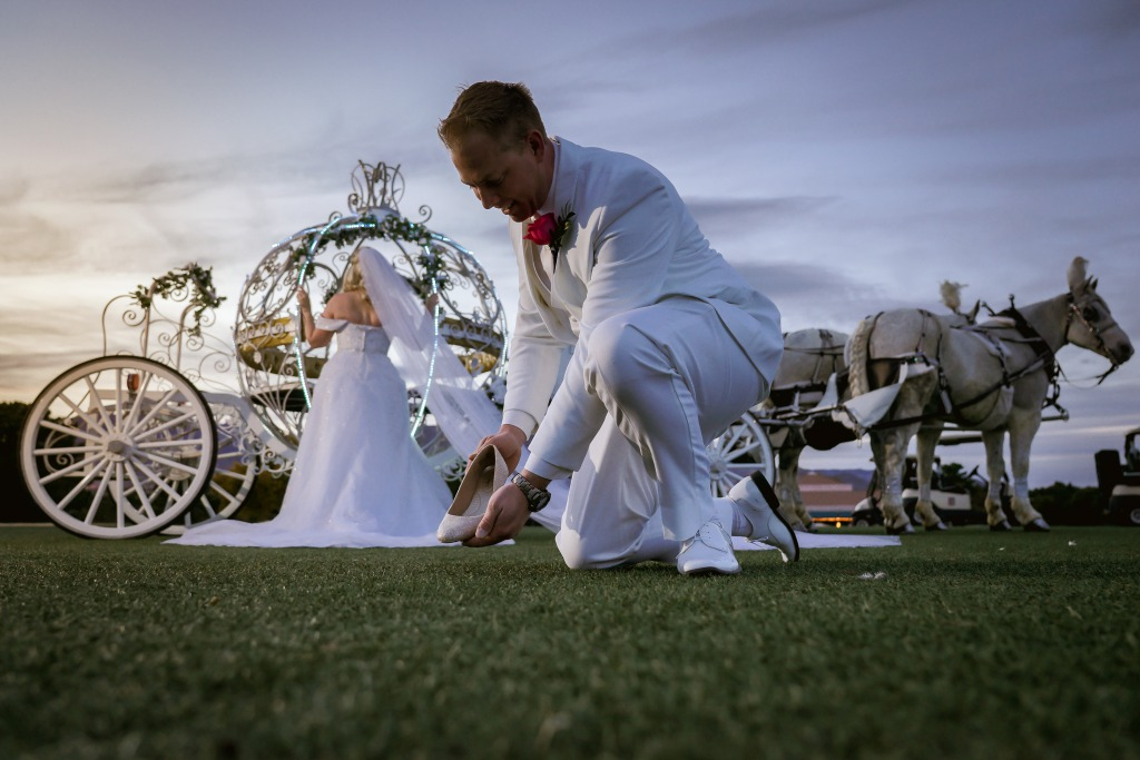 Las Vegas Couple getting married at country club with horse drawn cinderella carriage.