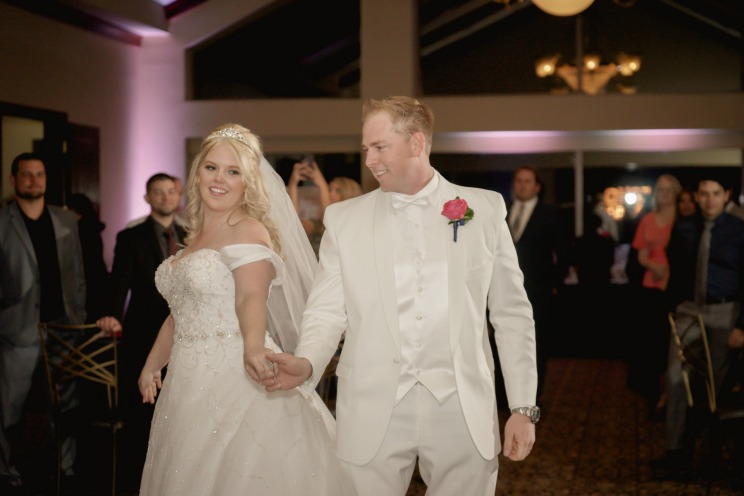 Bride and groom in white at TPC