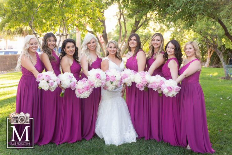 Bride with bridesmaids in purple gowns