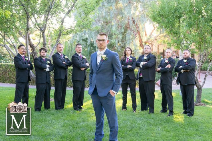 Groom in blue suit with groomsmen