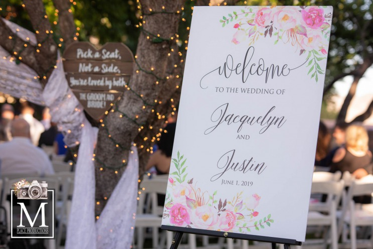 A welcome sign for a beautiful ceremony at the grove