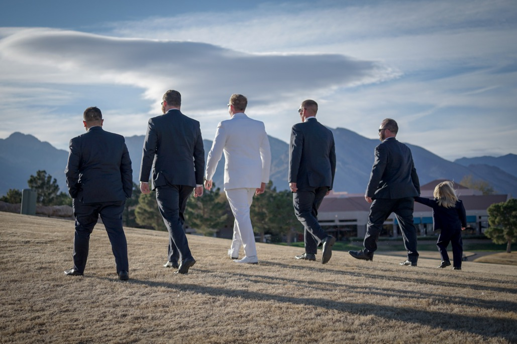 Groom in white tux with groomsmen