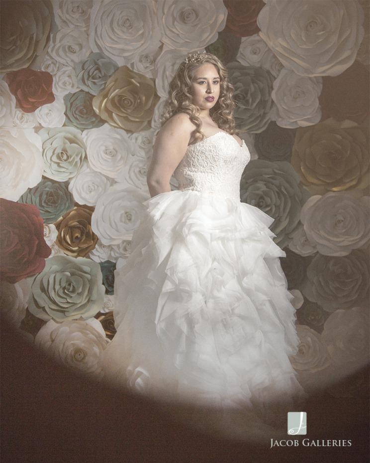 bride in front of flowerwall