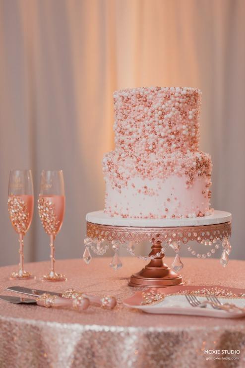 Elegant pink and rose gold wedding cake