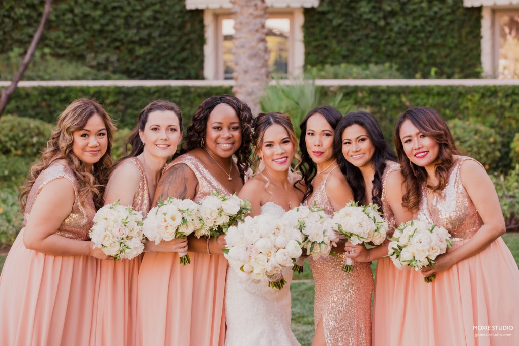 Bride with bridal party in rose gold dresses