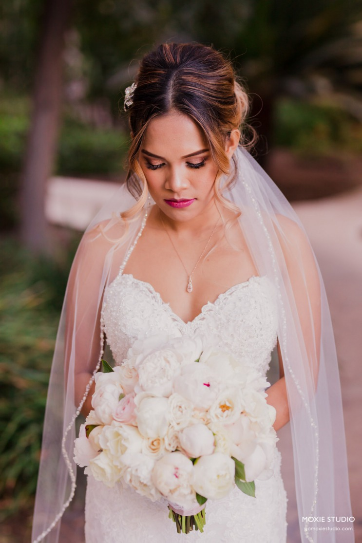 Bride in gown with white bouquet