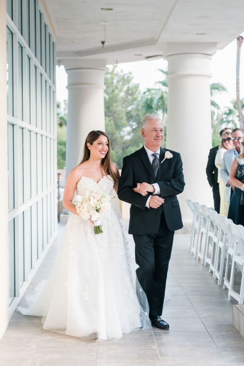 Bride getting walked by father down the aisle