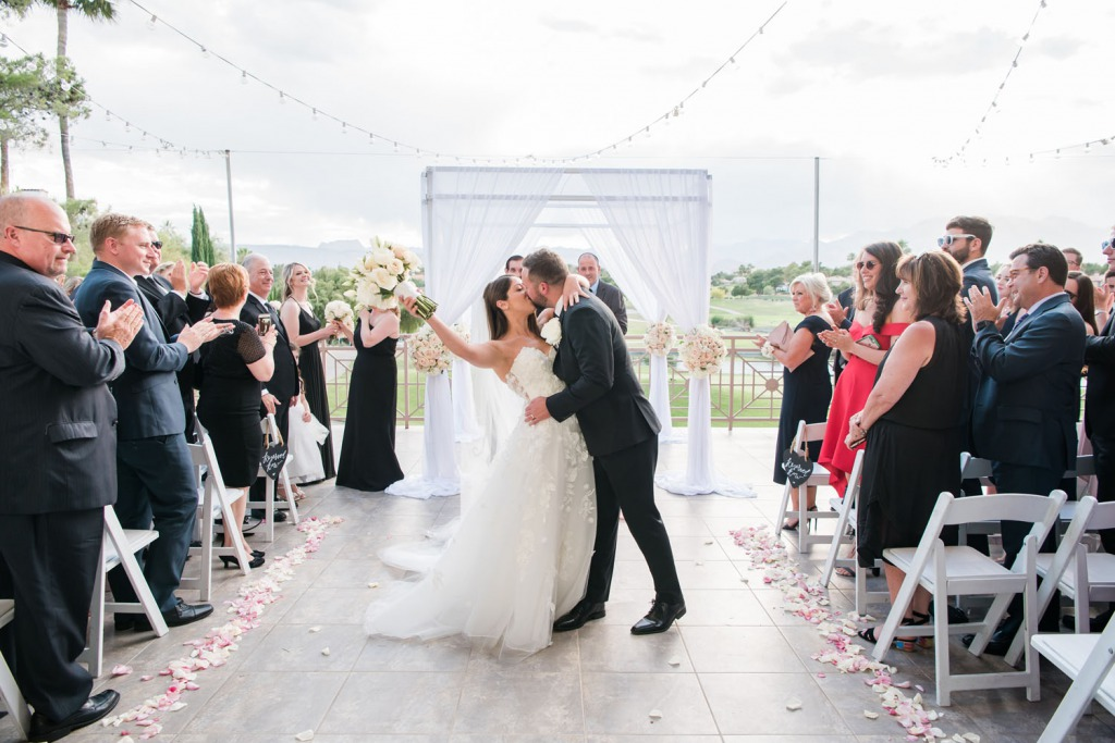 Bride and Groom celebrate a romantic wedding at Canyon Gate Country Club