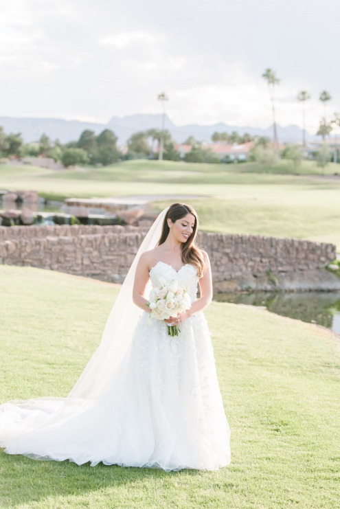 Just married happy bride outside at canyon gate country club