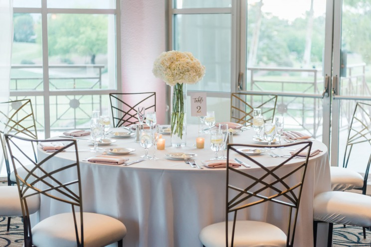 reception table with white, pink and cream flower table setting