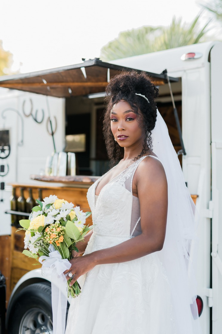 Bride at The Farm in Brillian Bridal Gown with mobile bar.