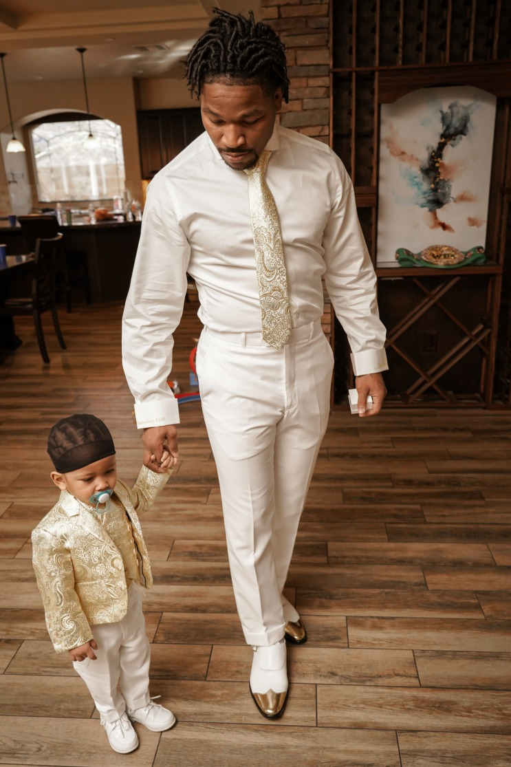 Groom and his son emerald and gold wedding