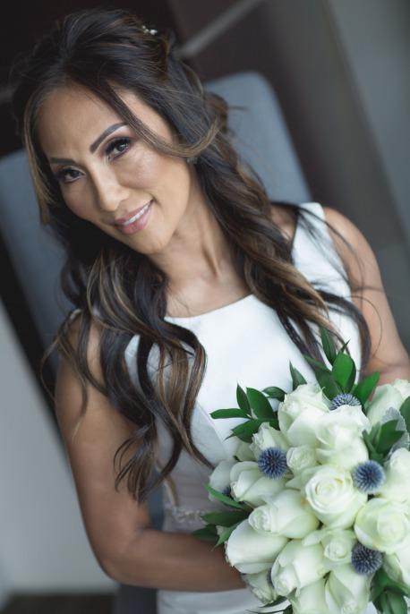 Bride at Reflection Bay blue and silver wedding