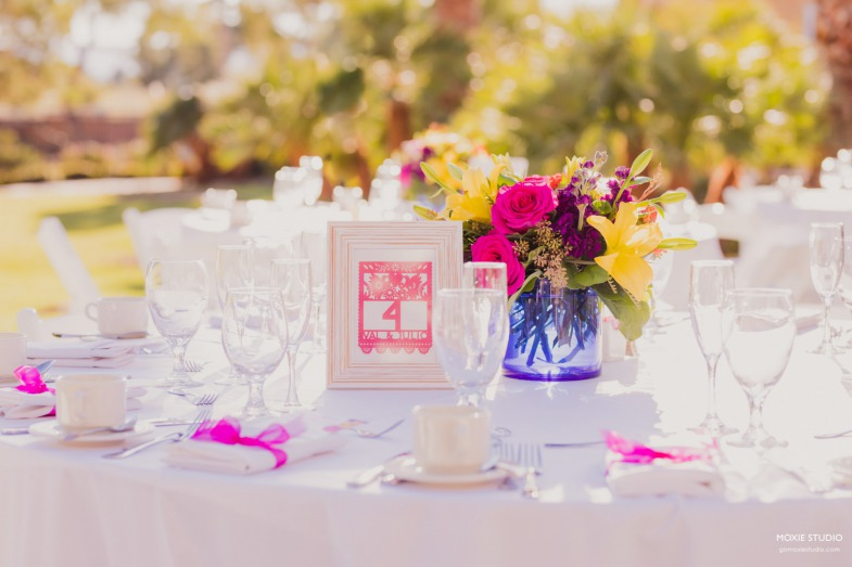 A beautiful fiesta-inspired table with white linen and bold centerpieces