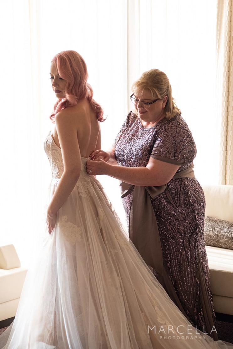 Bride in blush pink wedding gown