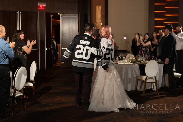 Bride and groom in Las Vegas Golden Knight Jersey