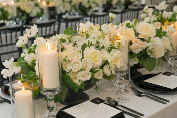 White floral centerpieces at a intimate wedding at the Lotus House.
