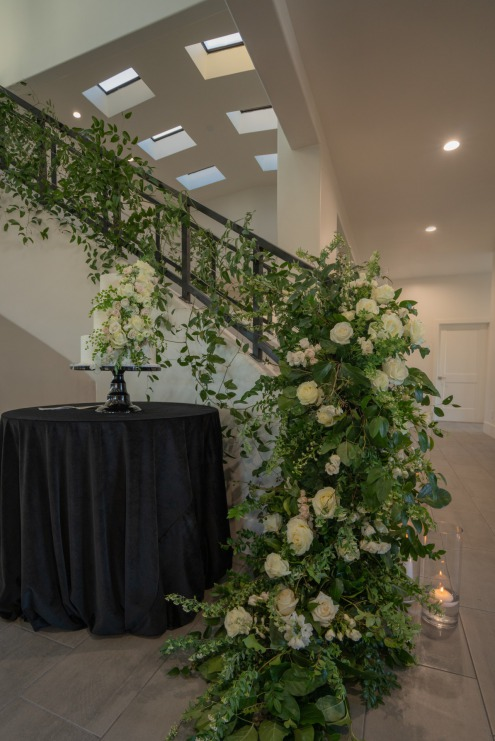 White floral adorned stairway at the Lotus House.