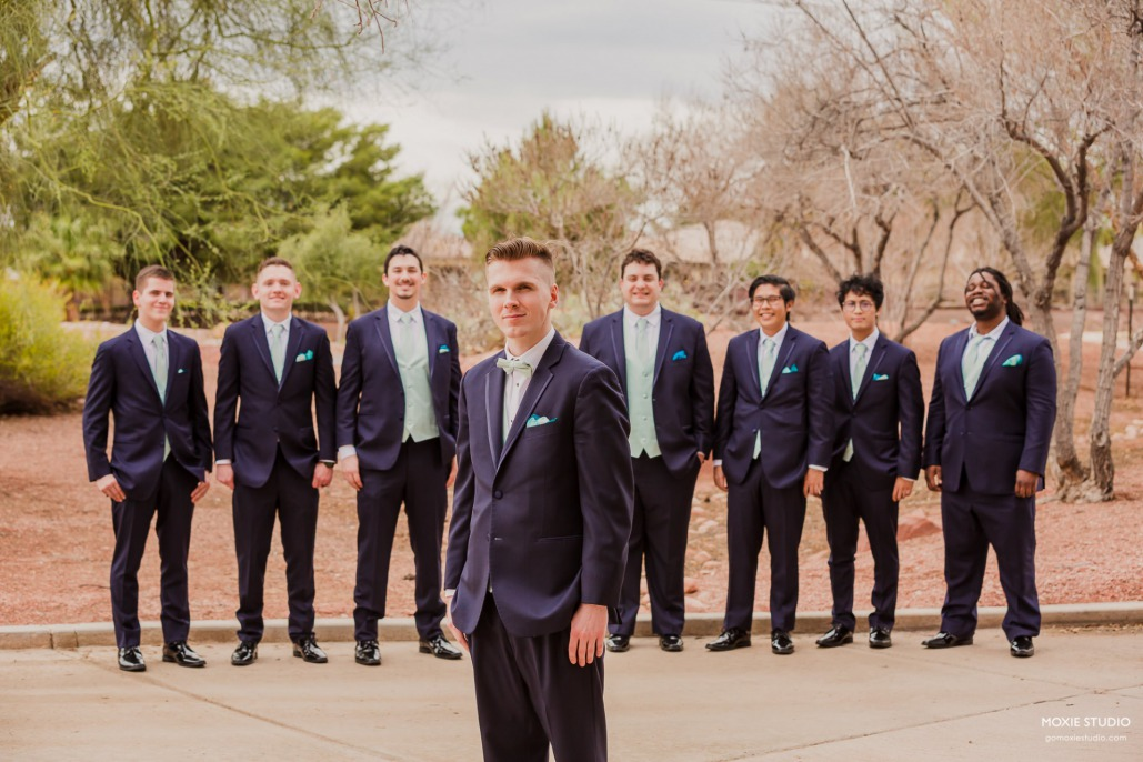 Groomsmen suits with mint green vests and ties