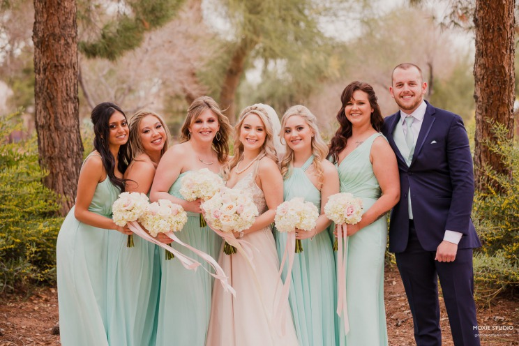 Bride with bridal party wearing mint green pops of color