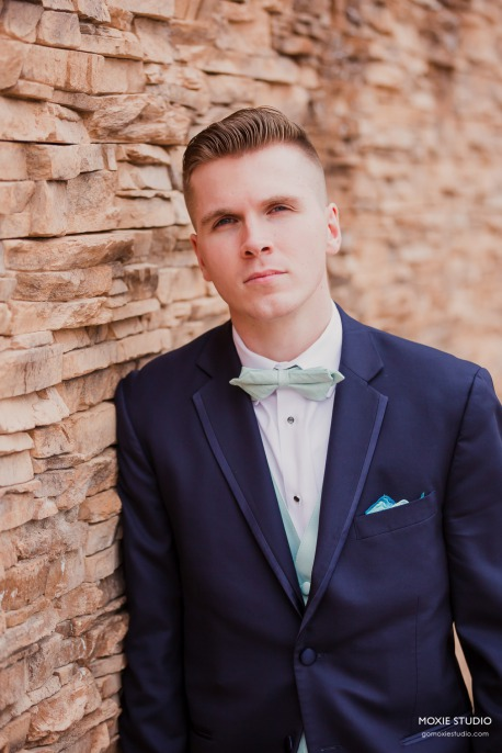 Groom with blue suit and mint green bowtie