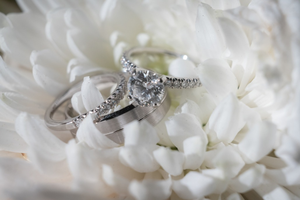 Bride and groom rings at A Secret Garden wedding