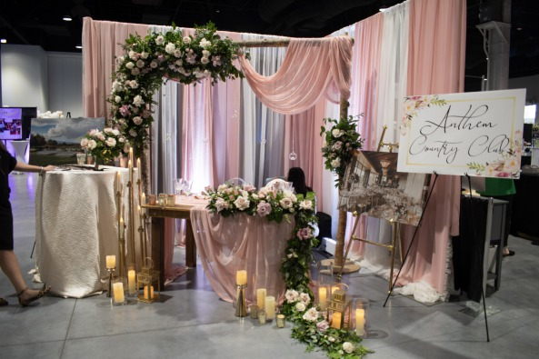Anthem country club booth is pretty in pink and white at Las Vegas Bridal Show Bridal Spectacular