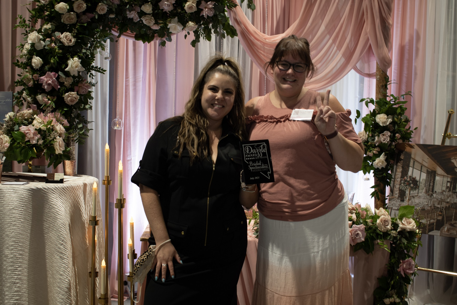 Anthem Country Club booth in petal pink with stunning flowers wins a dazzle award