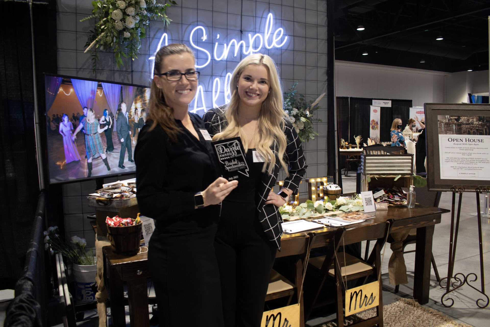 A Simple Affair receives dazzle award for their cute modern booth at bridal show