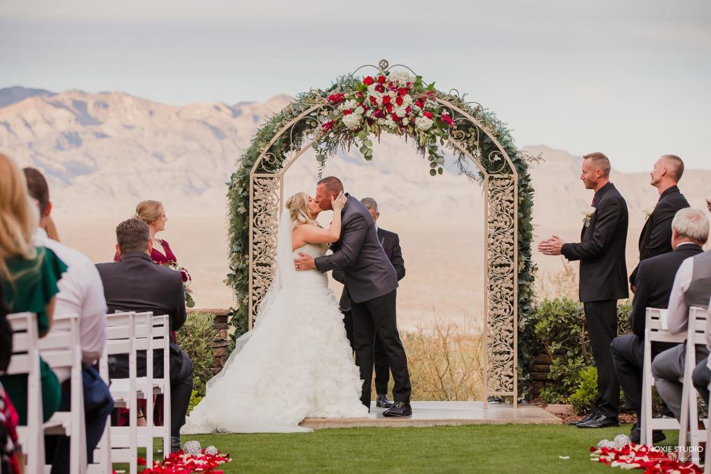 A Burgundy wedding outdoor ceremony